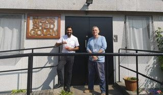 Humza standing outside Govan's Men Shed